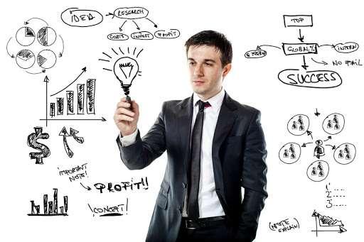businessman drawing a virtual business plan